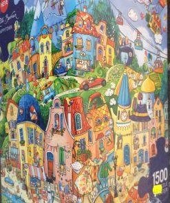 Puzzlespil/1500 brikker/Den glade by
